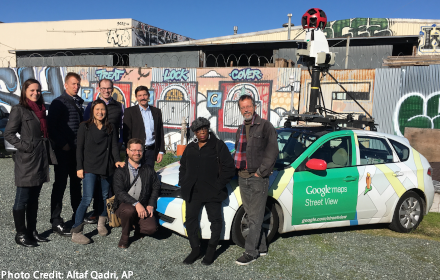The research team poses with its specially-outfitted Google Street View car