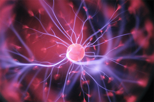 close-up of purple and pink plasma ball