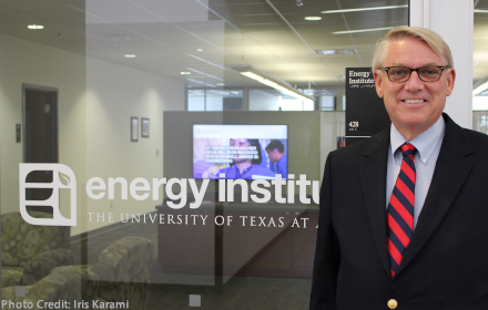 Dave Tuttle stands outside the entrance to the Energy Institute office