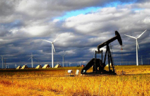 Wind turbines behind an oil pump