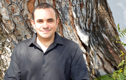 Elivan Martinez stands in front of a tree